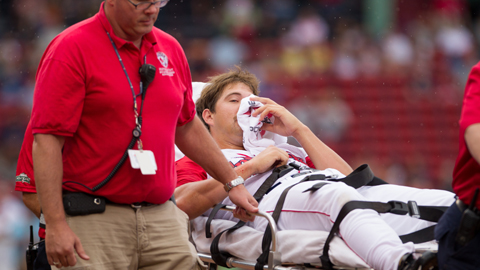 Brian Johnson is taken from the field on a stretcher in the first inning.